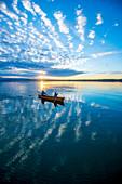 Evening canoe trip in Canadian on Lake Starnberg, Bavaria, Germany