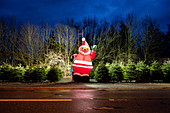 Big Santa Claus as a decoration at a Christmas tree sale, Munich, Bavaria, Germany