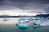 View of the Jokulsarlon glacier lagoon in southeast Iceland, with the Breidarmerkurjokull glacier tongue in the background, Iceland, Europe