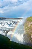 The Gullfoss waterfall, with rainbow in the sunshine, Iceland, Europe