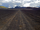 Black dirt road through the Fjallabak nature reserve, South Iceland, Iceland, Europe