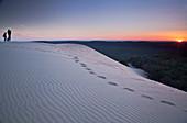 People photographing the sunrise from the Dune de Pilat, Dune de Pilat, Aquitaine, France