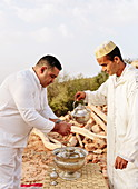 Performing a traditional hand-washing ritual with orange blossom, Morocco