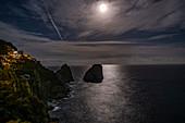Capri and the Faraglioni rocks at full moon, Capri Island, Gulf of Naples, Italy