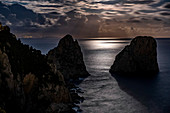 The Faraglioni rocks at full moon, Capri Island, Gulf of Naples, Italy