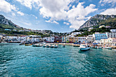 Marina Grande harbor and view of Capri, Capri Island, Gulf of Naples, Italy
