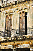 House facade with chair on the balcony in the streets of Havana. Cuba