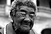 Portrait of an old woman with beautifully drawn wrinkles on her face. Havana. Cuba