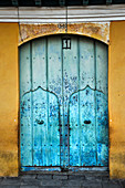 Blue gate in the streets of Trinidad. Cuba.