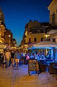 Restaurants in the Strada Mircea cel Bătrân in the old town of Constanta in the evening, Dobruja, Black Sea coast, Romania