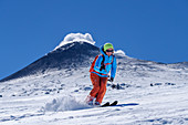 Woman on ski tour starts from Etna, UNESCO World Heritage Monte Etna, Etna, Etna, Sicily, Italy
