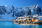 Hamnoy by the sea with snowy mountains, Hamnoy, Lofoten, Nordland, Norway
