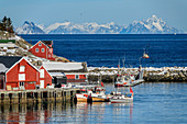 Norwegian fishermen's houses by the sea with mountains in the background, Klingenberg, Lofoten, Nordland, Norway