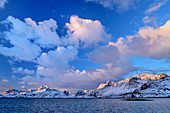 Cloudy mood over snowy mountains and fjord, Lofoten, Nordland, Norway