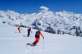 Three people go on a ski tour, Lyfispitze, Ortler Group, South Tyrol, Italy