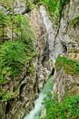 Woman hiking through the Kaiserklamm, Brandenberger Ache, Bavarian Alps, Tyrol, Austria
