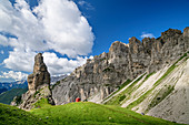 Rock tower with small red bivouac box stands against mountain backdrop, Val Cimoliana, Dolomites, UNESCO World Heritage Dolomites, Veneto, Italy