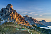 Alpine glow on Ra Gusela and Tofana, alpine hut in the foreground, Dolomites, UNESCO World Heritage Dolomites, Veneto, Italy
