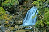 Waterfall with autumn leaves, Kuhfluchtfalls, Estergebirge, Bavarian Alps, Upper Bavaria, Bavaria, Germany