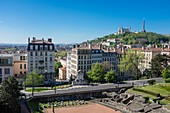 France, Rhone, Lyon, historical site listed as World Heritage by UNESCO, Croix Rousse district, Burdeau fountain at the foot of the Amphitheatre of the Three Gauls and Fourviere hill in the background