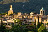 France, Vaucluse, Parc Naturel Regional du Luberon (Natural Regional Park of Luberon), Lourmarin, labelled Les Plus Beaux Villages de France (The Most Beautiful Villages of France), the Tower of the clock and the chocher of the church, the massif of Lubéron in background