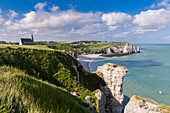 France, Seine Maritime, Pays de Caux, Alabaster Coast, Etretat, Notre Dame de la Garde chapel, protector of the fishermen, perched on Amont cliff and Aval cliff in the background