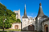 France, Eure, Le Bec Hellouin, Notre Dame du Bec Abbey, 11th century Benedictine monastic foundation, the towers of the former medieval gate and Saint Nicolas tower in the background