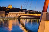 France, Rhone, Lyon, historical site listed as World Heritage by UNESCO, gateway of the Palace of Justice on the Saone connecting the district Cordeliers with the district of Vieux Lyon, view of Notre Dame de Fourviere