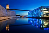 France, Bouches du Rhone, Marseille, Euromediterranean area, the tower of Fort Saint Jean, 17th century Historical Monument, and MuCEM Museum of Civilization in Europe and the Mediterranean, R. Ricciotti and R. Carta architects, lighting Yann Kersale