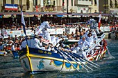 France, Herault, Sete, Festival of Saint Louis, jousters on the tintaine aboard the traditional boats with reams armed with their lances and protected by their shields