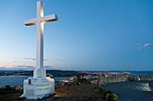 France, Herault, Sete, Cross of the Saint Clair Mount at dusk view from the panorama with background Thau pond