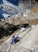 Young climber climbs on a rope in granite, Gigalitz, Zillertal Alps, Tyrol, Austria