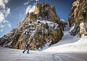 Ski tourer ascending to the Cima Tosa north channel, Brenta Group, Italy