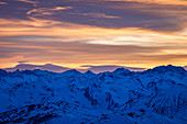 Sunset with colorful sky and exciting cloud formations over the Stubai Alps, Tyrol, Austria
