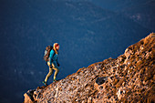 Young blonde climber climbs over a ridge-like back, Karwendel, Tyrol, Austria