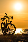 A beach cruiser on the beach at sunset, Fort Myers Beach, Florida, USA