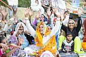 2015, Nandgoan / Nandagram, Vrindavan, Uttar Pradesh, India, women sing at a school event and give the guests blessings
