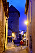 Woman walks in the evening in the alleys of Arbois, Jura, Franche Comté, Eastern France
