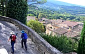 View from the upper town with hikers, Bonnieux in the Luberon, Provence, France
