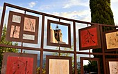 Small art board with pictures and mirrors in Roussillion in the Luberon, Provence, France