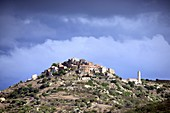 Storm clouds over the mountain village of Sant Antonino in the Balagne region, northern Corsica, France