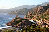 Porto with medieval tower and beach on the Gulf of Porto, western Corsica, France