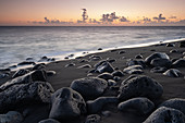 View of the sunset on the black beach in the fishing village of la Bombilla, La Palma, Canary Islands, Spain, Europe