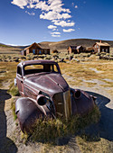 Rusted classic car in the ghost town of Bodie, an old gold mining town in California, USA