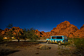 Camping Van at night with a starry sky in the Valley of Fire, USA