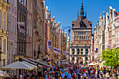 Gdansk, Main City, old town, Dluga (Long) street, Golden Gate, behind roof and tower of former prison and torture chamber. Gdansk, Main City, Pomorze region, Pomorskie voivodeship, Poland, Europe