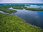 Aerial of islands and three Le Boat Horizon houseboats on Newboro Lake, near Newboro, Ontario, Canada, North America