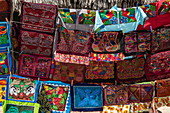 Handicrafts with traditional indigenous art motif for sale at souvenir stand, Isla Aroma, San Blas Islands, Panama, Caribbean