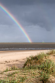 Rainbow over sailing ship in the Wadden Sea, Schillig, Wangerland, Friesland, Lower Saxony, Germany, Europe