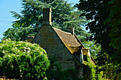 View of an old, small cottage in the park, Branston, Lincolnshire, England